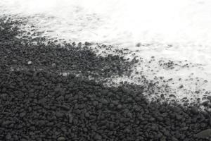 Hard pebble sands of Black Sand Beach