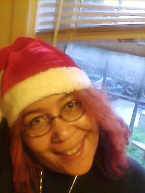 Sumiko Saulson in santa hat