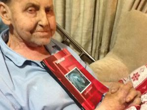 "My proud poppa Robert Saulson, holding a copy of my first book ""Solitude"", which he kept by his bedside. Photo taken Dec. 30, 2012."