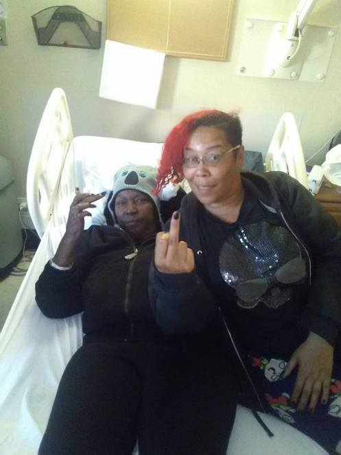 Carolyn and Sumiko Saulson flip off the camera at Windsor Care in Vallejo